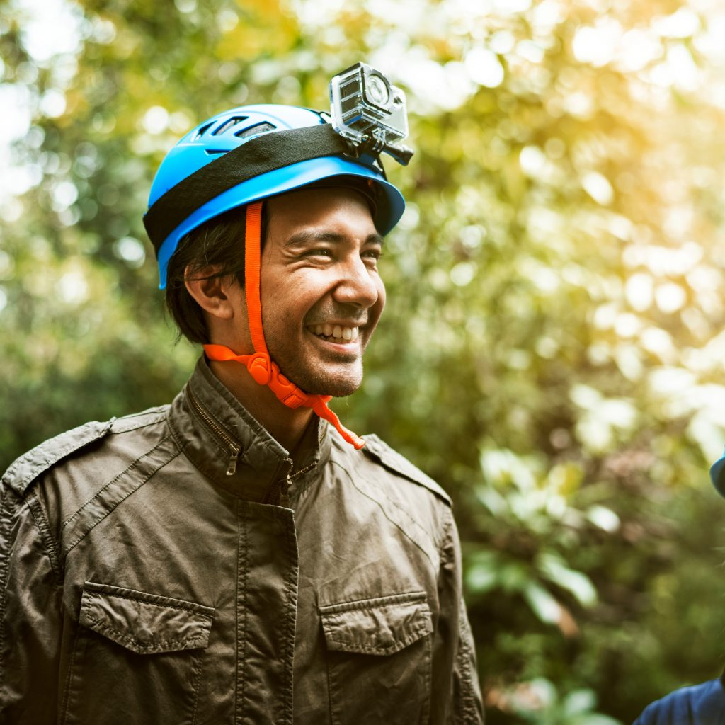 Man smiling wearing safety equipment