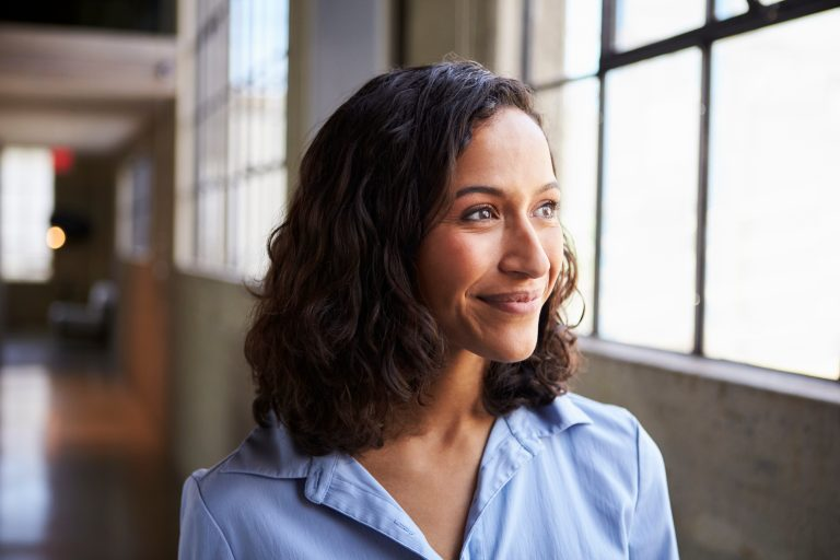 Woman smiling looking into the distance