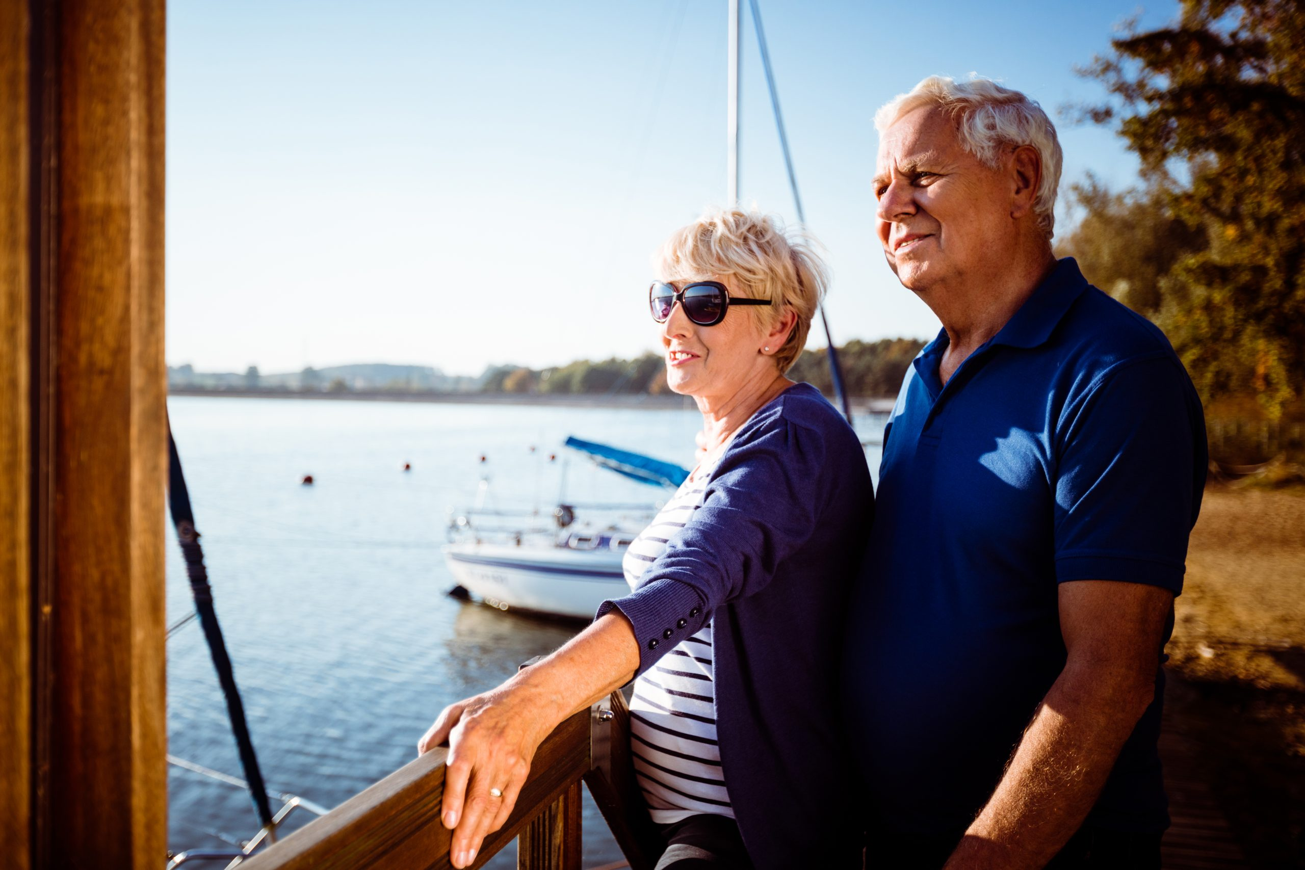 Elderly couple looking out across the water