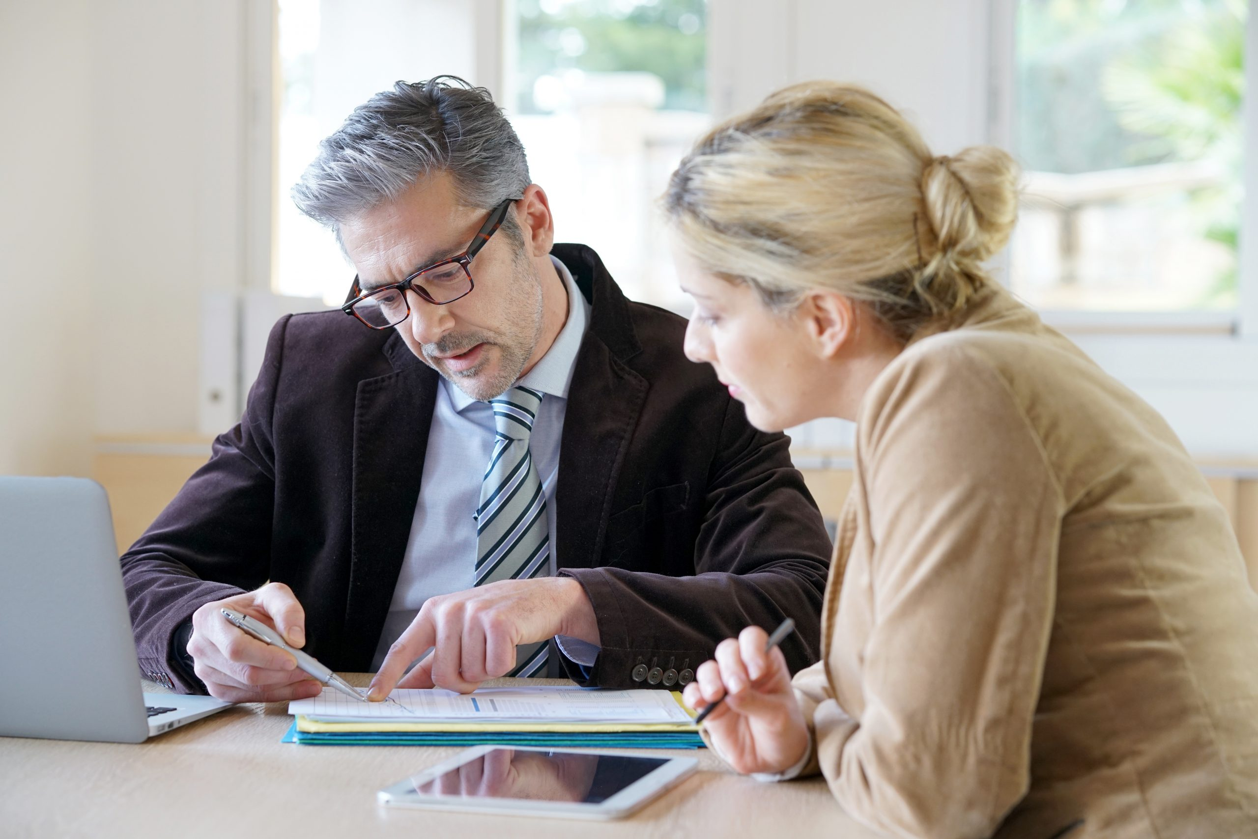 Woman sat with consultant discussing paperwork